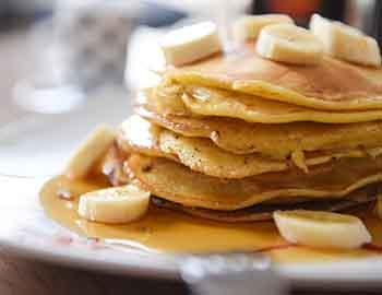Pancake stack with banana slices on top