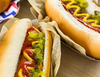 Hot dogs with ketchup, mustard and onion