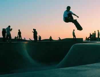 Skateboarder jumping in the air at a skate park
