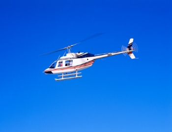 Helicopter soaring through the air