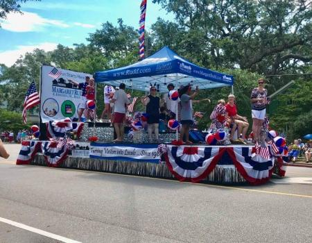 People on a parade float in the Southport, NC parade