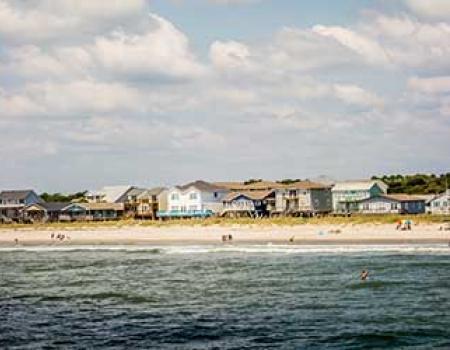 Oceanfront houses along Oak Island beach