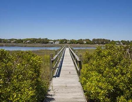 Pier and path to the water from a sound front vacation rental