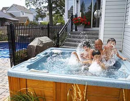 Family in a hot tub at a vacation rental home