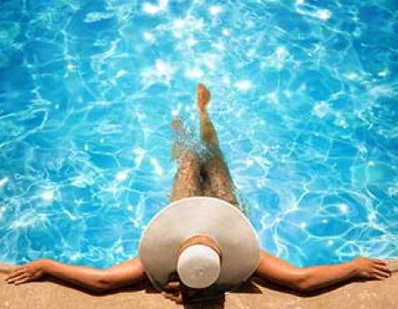 Woman soaking in a private pool at a vacation rental home
