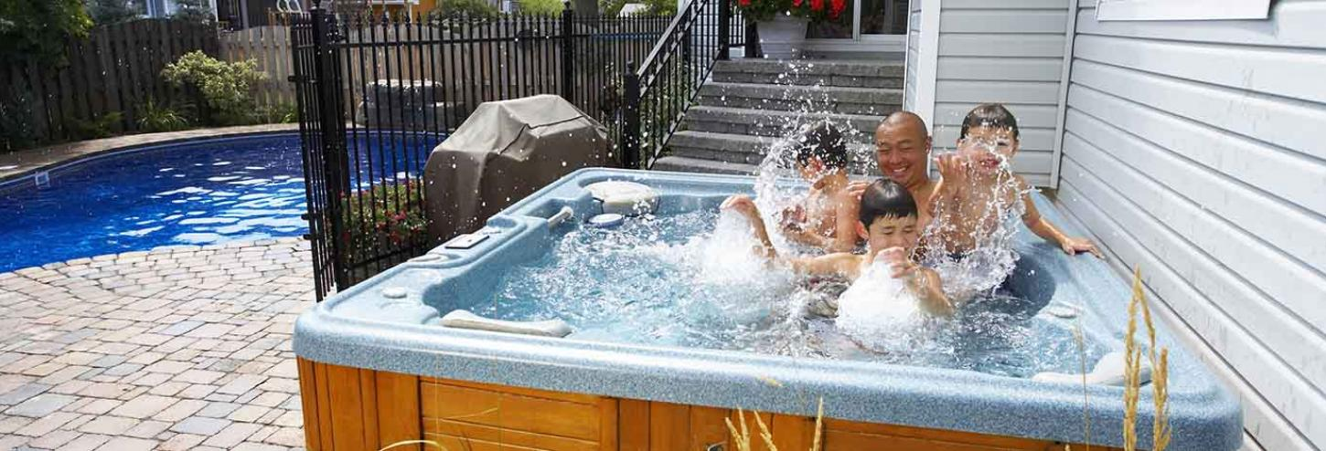 Family enjoying a hot tub at a vacation rental
