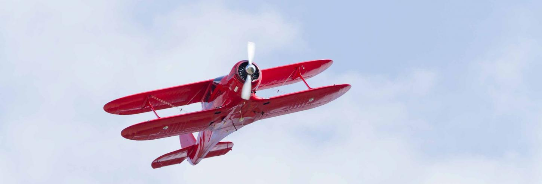 Biplane flying through the sky
