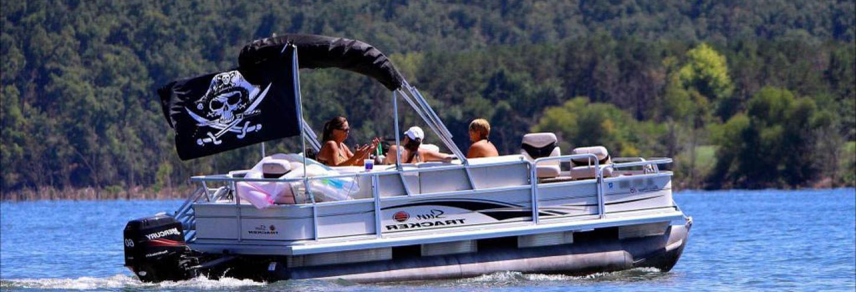 Friends enjoying a pontoon boat ride together