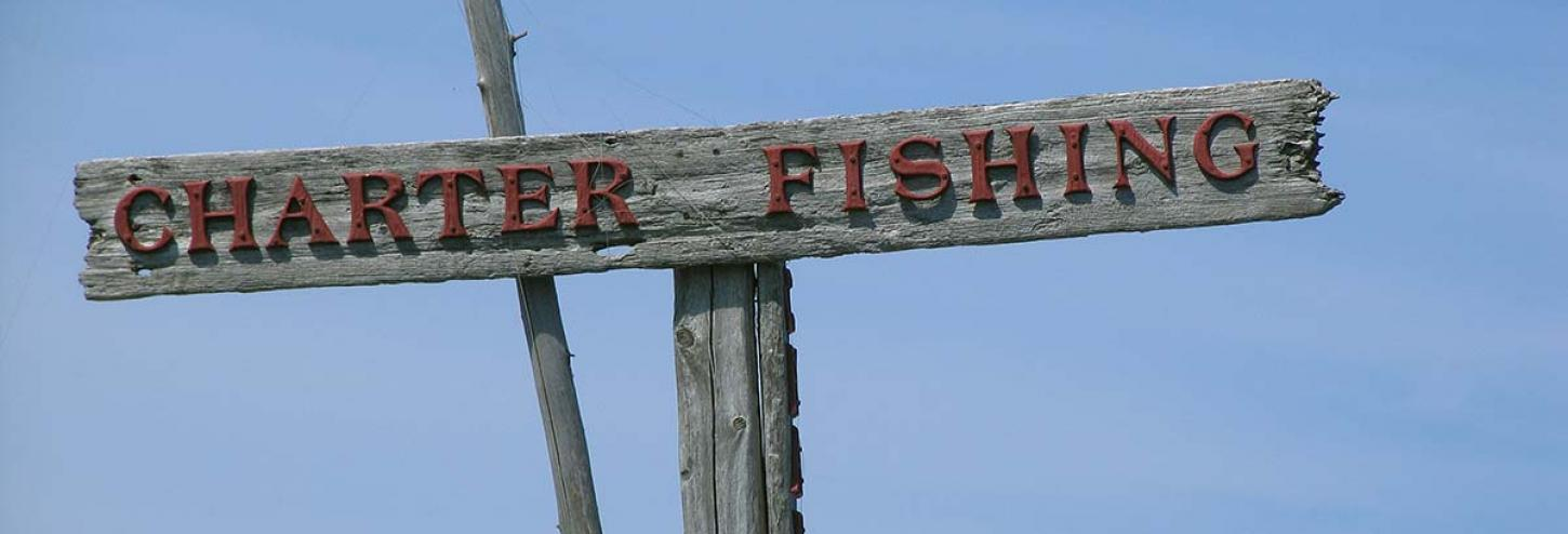 Fishing charters sign on a bright blue background