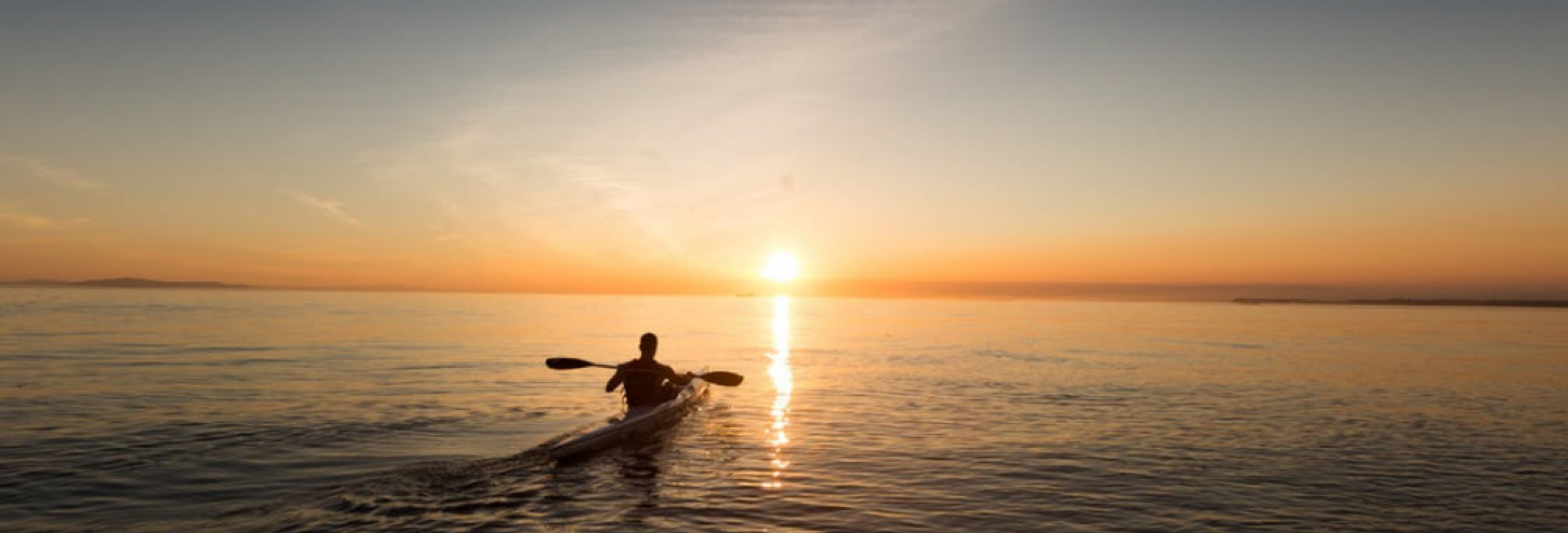 Kayaker on the water during a beautiful sunset