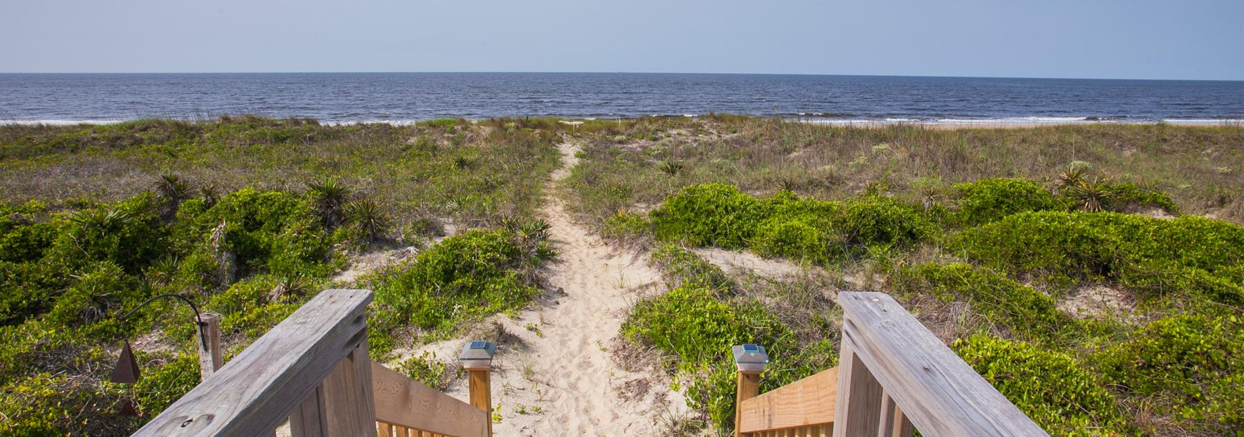 View of Oak Island beach from a vacation rental home