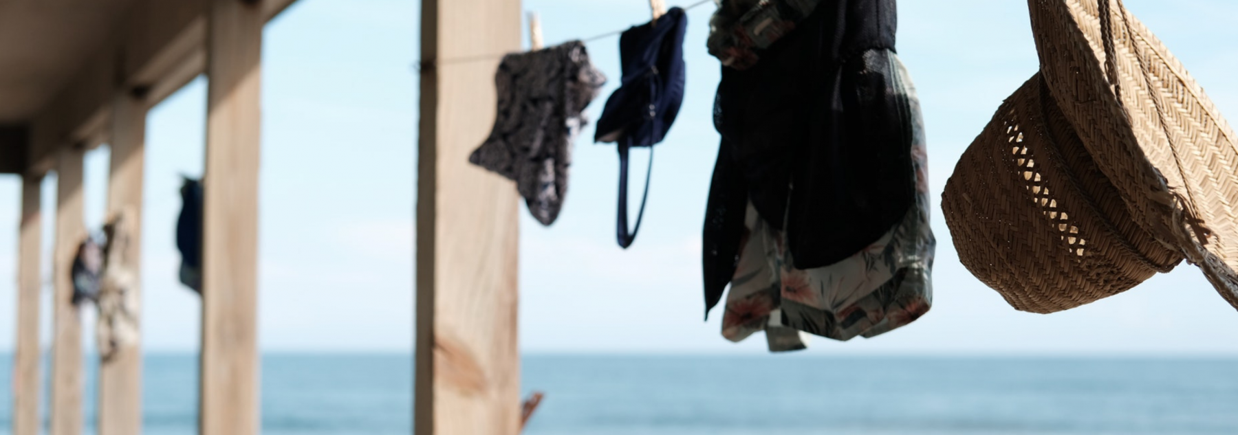 Hats and clothes hanging from a clothes line at an Oak Island vacation rental