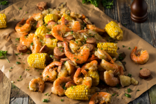 Shrimp boil local seafood shrimp kielbasa sausage corn spice low country boil