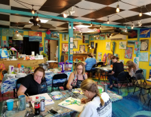 Margaret Rudd employees enjoying an art class together