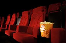 Movie theatre chairs with popcorn buckets