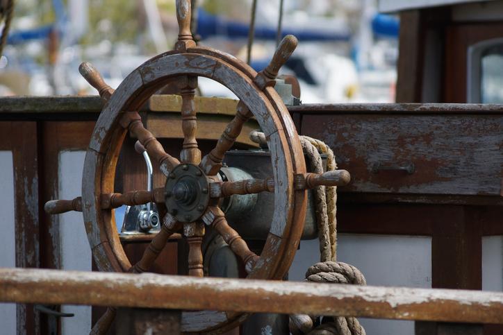 A ship wheel at a maritime museum