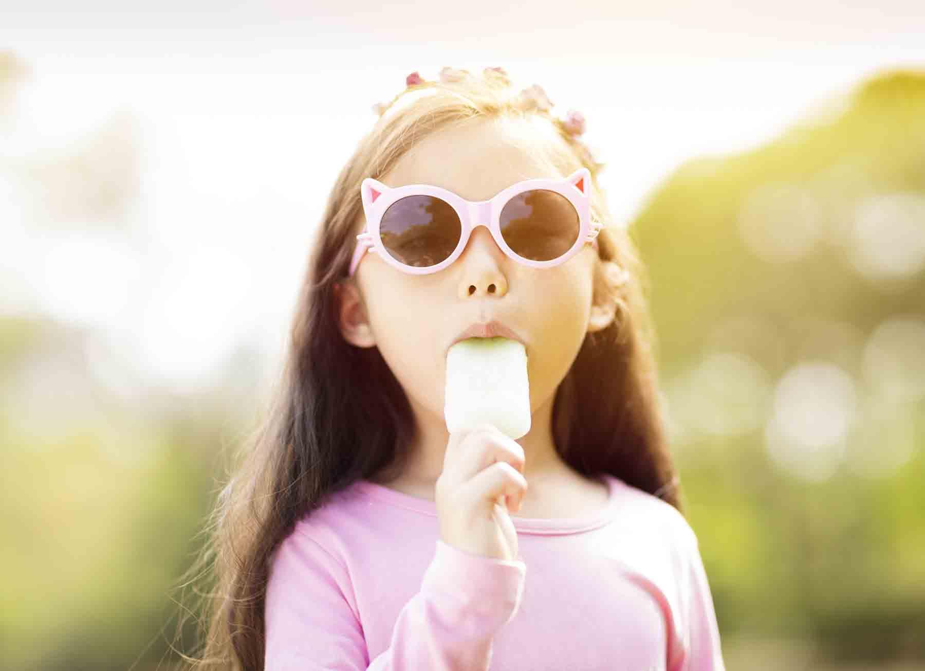 Girl enjoying a fruit pop