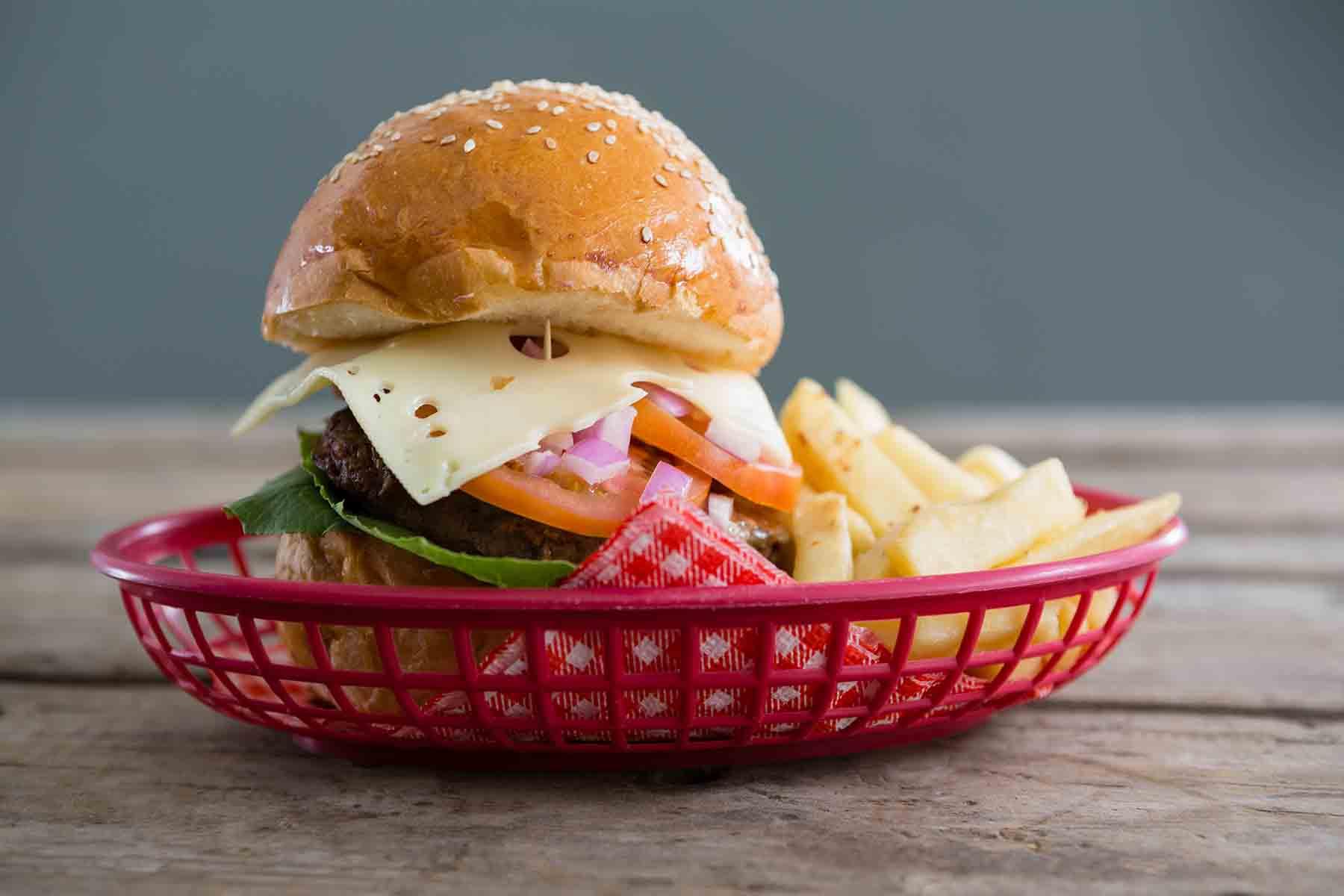 Burger basket on a picnic table outside