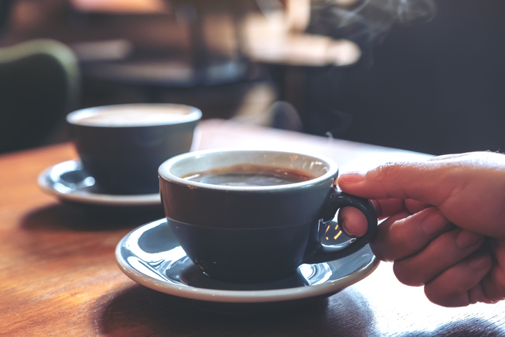 steam cup of coffee at a cafe
