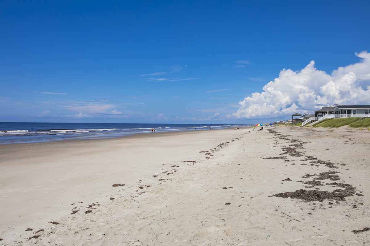 Sandy beach on a sunny day in Oak Island, NC