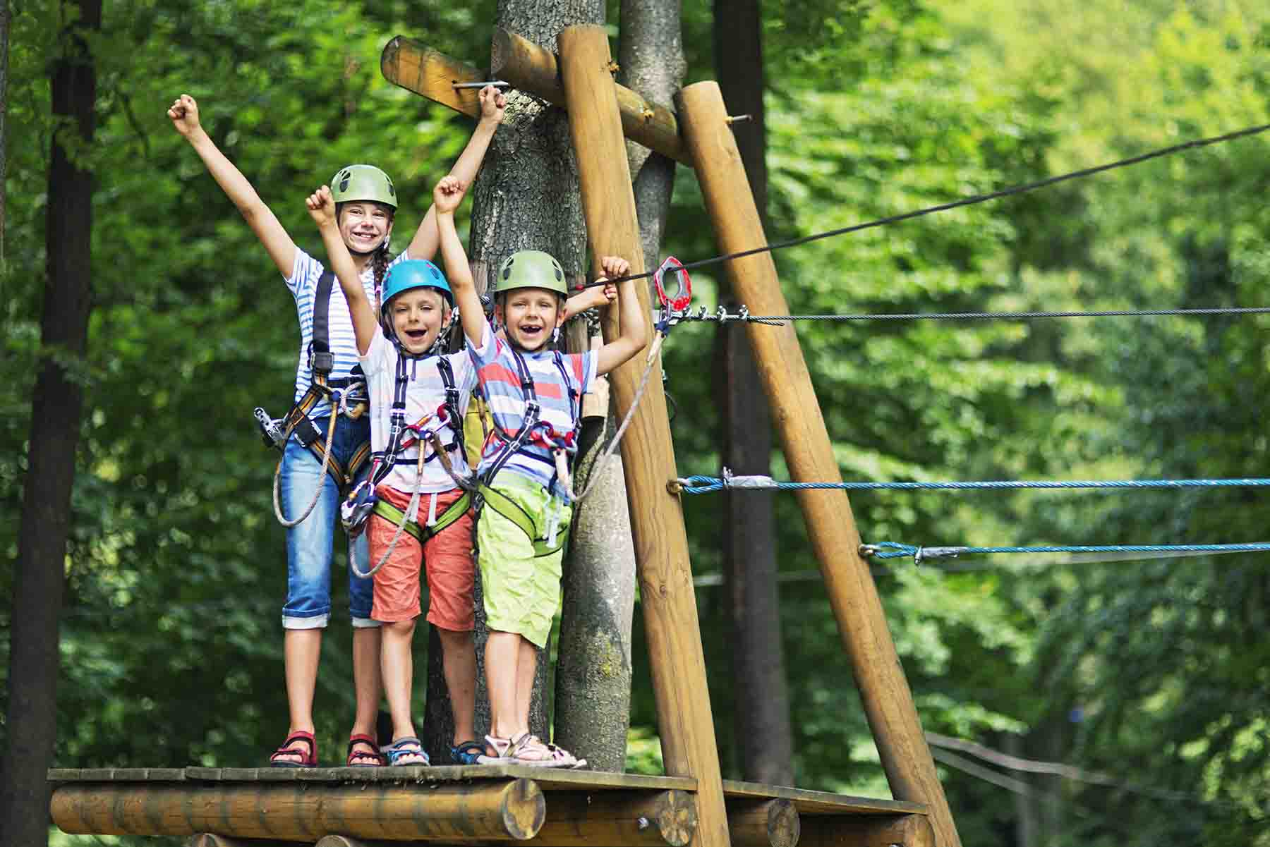 Kids zip lining at Shallotte Park in North Carolina